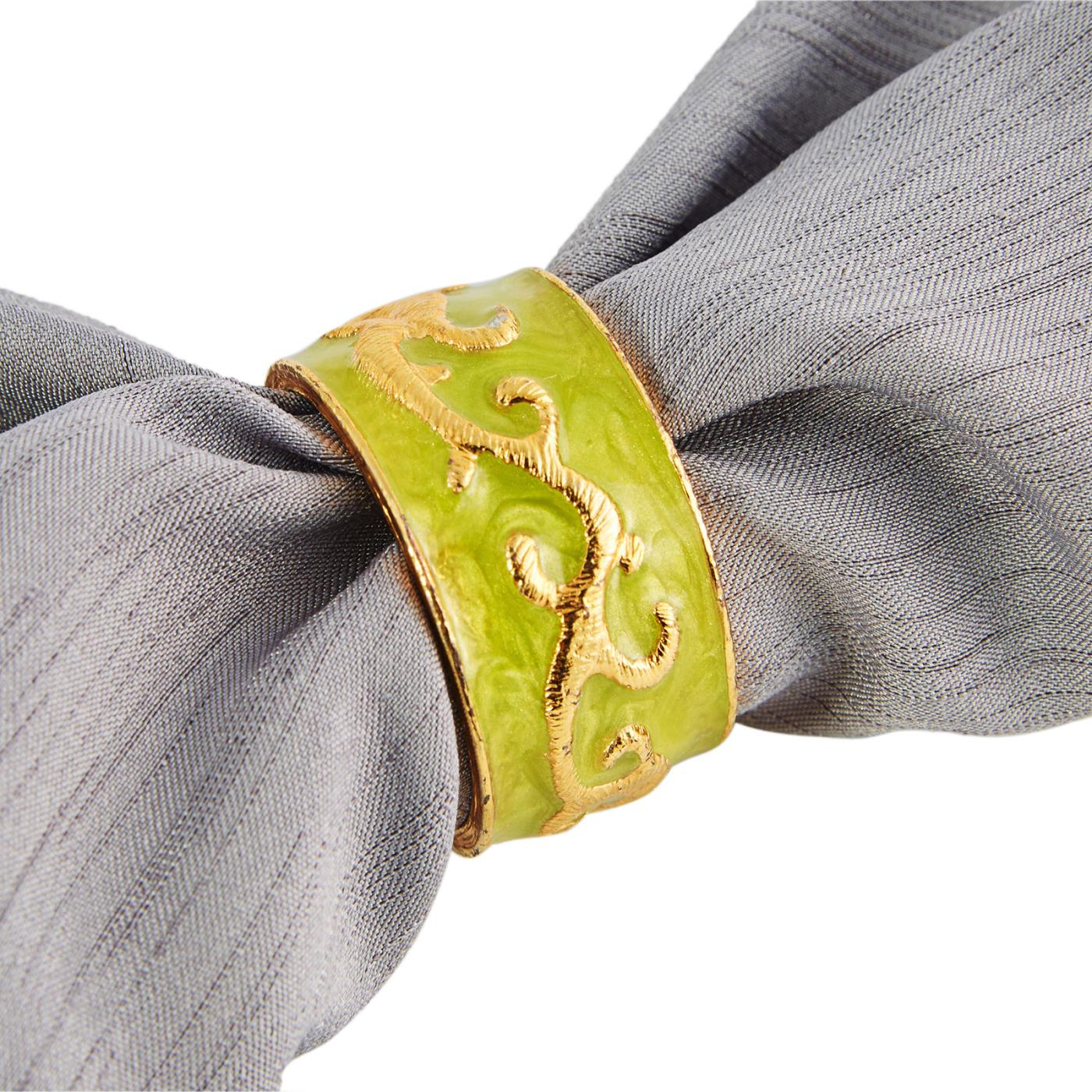green and gold napkin ring on grey napkin